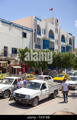 TUNISIA-CIRCA MAY, 2012: Road traffic is on the streets of Tunisian provincial town. Passengers cars, vehicles, motorcycles and bycycles drive on narr - Stock Photo