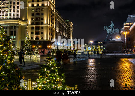Christmas Trees with Canopy of Lights at Manezhnaya Square at Night. Festive New Year decorations in Moscow before upcoming winter holidays, Moscow, R - Stock Photo