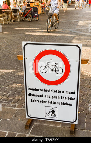 GARDA, LAKE GARDA, ITALY - SEPTEMBER 2018: Sign on the promenade in Garda on Lake Garda asking cyclists to dismount and push their bikes for safety re - Stock Photo