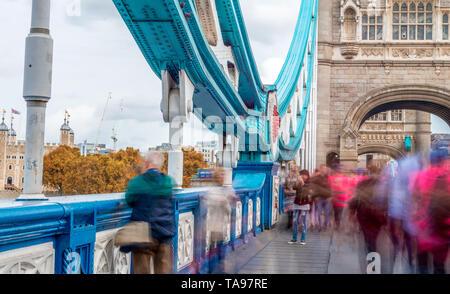 LONDON - SEPTEMBER 25, 2016: Traffic under Tower Bridge. London attracts 30 million tourists annually. - Stock Photo