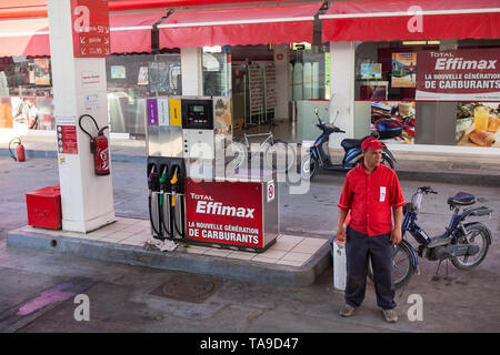 TUNISIA, AFRICA-CIRCA MAY, 2012: Service man is on petrol station with Total Effimax gasoline. Effimax is the new generation of advanced fuel created  - Stock Photo