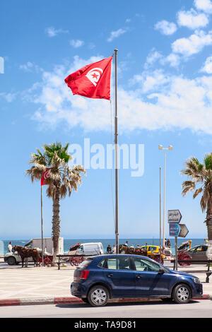 SOUSSE, TUNISIA-CIRCA MAY, 2012: Car parking is near the Bou Jaafar beach in Avenue Hedi Chaker, Boulevard de la Corniche. It is sandy strip of beach - Stock Photo