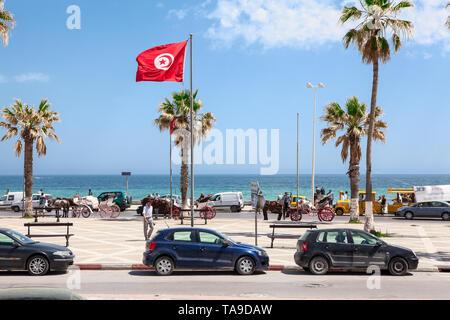 SOUSSE, TUNISIA-CIRCA MAY, 2012: The Bou Jaafar beach is in Avenue Hedi Chaker, Boulevard de la Corniche. It is sandy strip of beach is popular playgr - Stock Photo