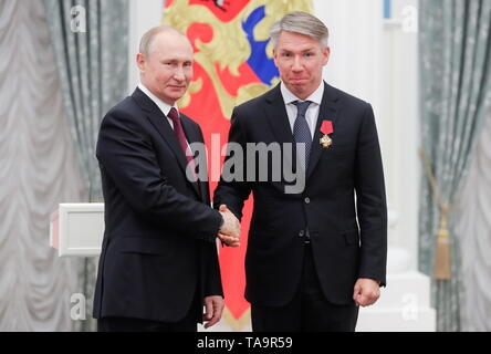 Moscow, Russia. 23rd May, 2019. MOSCOW, RUSSIA - MAY 23, 2019: Russia's President Vladimir Putin (L) and Russia 2018 Local Organizing Committee CEO Alexei Sorokin, awarded the Order of Merit for the Fatherland (4th class), during a ceremony to present state decorations at Moscow's Kremlin. Mikhail Metzel/TASS Credit: ITAR-TASS News Agency/Alamy Live News - Stock Photo