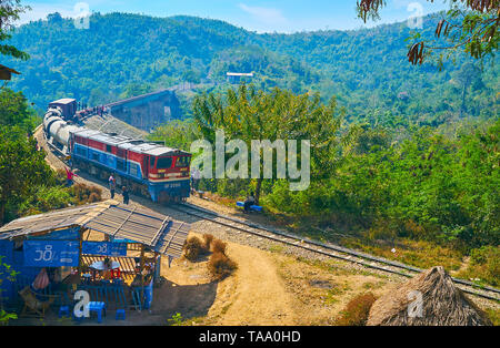 HEHO, MYANMAR - FEBRUARY 19, 2018: The old train rides along the old arch Bawa Than Tha Yar Bridge, stretching over the deep gorge in mountains of Sha - Stock Photo