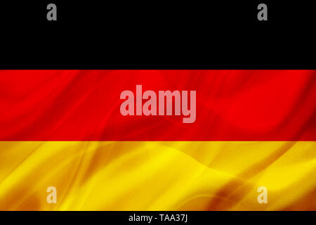 Germany country flag symbol on silk or silky waving texture. Smooth fabric or material - Stock Photo