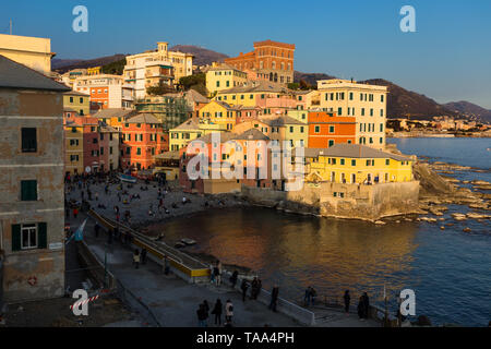 GENOA, ITALY, MARCH 23, 2019 - View of Genoa Boccadasse at sunset, a fishing village of colorful houses, in Genoa, Italy. - Stock Photo