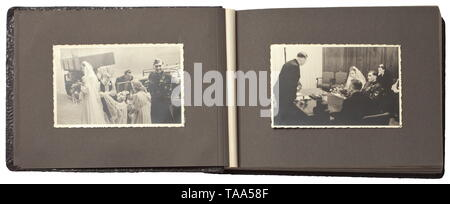 A photo album of an SS-Rottenführer in the Waffen-SS - marriage ceremony and campaign in France Album with a total of 84 images, including the marriage ceremony with an SS-Sturmmann as groomsman (a wearer of the Blood Order and Coburg Honour Badge), an SS-Untersturmführer and other comrades. The majority of the images show pledges, sports and the advance into France (tank and combat images, soldier's graves). Interesting contemporary documentation. historic, historical, 20th century, 1930s, 1940s, Waffen-SS, armed division of the SS, armed service, armed services, NS, Natio, Editorial-Use-Only - Stock Photo