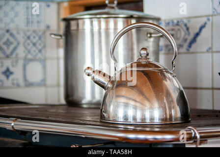 pot and kettle on the wood fired stove - Stock Photo