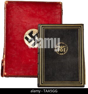 Adolf Hitler - presentation volume for his visit in Italy 1938 Magnificent presentation volume with the signatures of all members of Local Groups Milan (334), Rome (184), Turino (82), Genoa (65), Merano (61), Naples (88), Venice (42), Trieste (28), Florence (40) etc, all together 1169 signatures on parchment. A calligraphic dedication on the flyleaf from the national group leaders, diplomatic envoys in Italy, and SS-Brigadeführer Erwin Ettel with a signature 'Ettel' in his own hand. Dark-blue leather binding stamped in gold. In a red leather velvet lined presentation case (, Editorial-Use-Only - Stock Photo