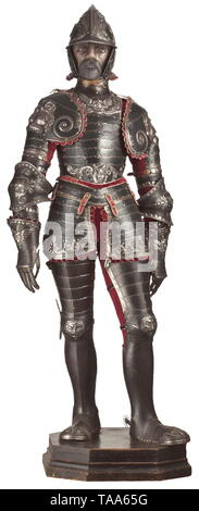 An embossed armour alla romana in the style of circa 1540, in the manner of Caremolo Modrone of mantua, partly 19th century Embossed throughout with mannerist designs of scrolling acanthus and volutes, involving grotesque masks and with a pair of large demon masks centrally over the spauldrons, comprising burgonet with one-piece skull, each side with a voluted scroll developing in a spray of acanthus swept over the brow and diminishing towards the nape, pointed peak and neck guard, a pair of hinged cheekpieces (associated) and with recessed borde, Additional-Rights-Clearance-Info-Not-Available - Stock Photo