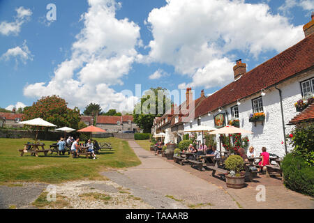 The picturesque Tiger Inn at East Dean, East Sussex; popular with walkers and hikers on the South Downs, UK - Stock Photo