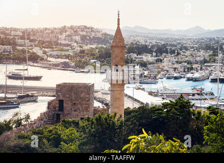 Mosque with tower at Bodrum Castle museum and view to harbor in Turkey - Stock Photo