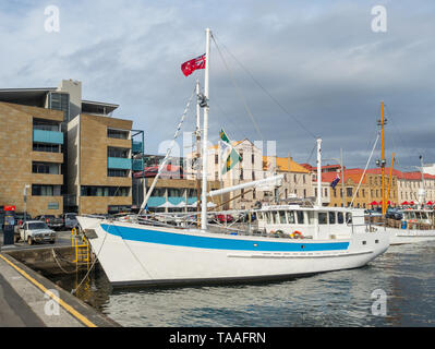 TASMANIA, AUSTRALIA - FEBRUARY 16, 2019: Fishing boats moored at Elizabeth Street Pier in Hobart in Tasmania, Australia. - Stock Photo