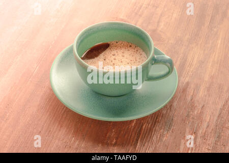 A cup of black coffee on a dark rustic wooden background, toned image - Stock Photo