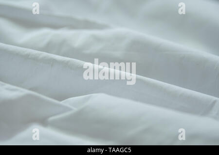 A simple isolated white cloth background with natural curves in a white cloth - Stock Photo