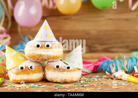 Carnival background with party decoration and cake - Stock Photo