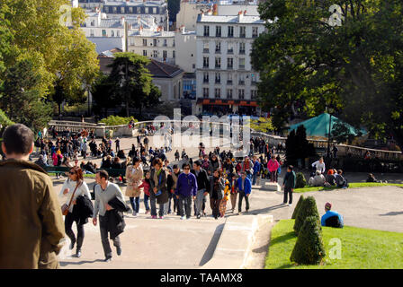 Crowds walking up the steps leading to the Basilica of Sacre Coeur, Montmartre, Paris, France - Stock Photo
