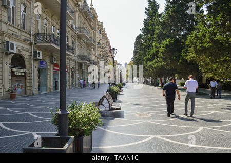 Baku, Azerbaijan, September 03, 2013: people walking and resting near fountain square - Stock Photo