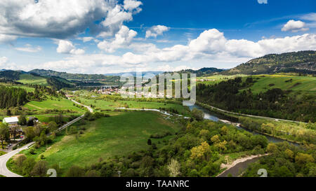 Dunajec river flowing trough valles and countryside in Poland, aerial drone view. - Stock Photo