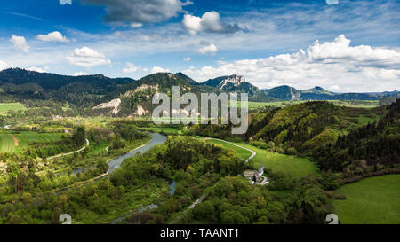 Dunajec river flowing towards Three Crowns mountain peak in Poland. Aerial drone view. - Stock Photo