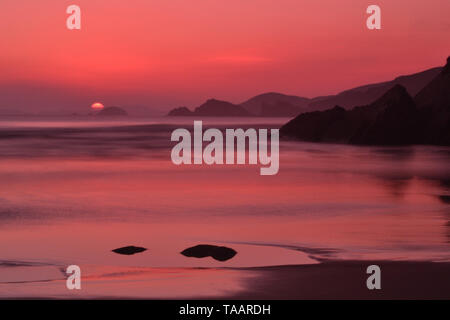 Photograph taken at sunset on Newgale beach, West Wales - Stock Photo