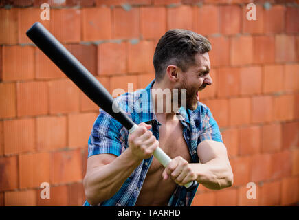 Go wild. unshaven muscular man fighting. man with baseball bat. i am a criminal. outdoor sport activity. Hooligan man hits the bat. Bandit gang and conflict. aggression and anger. full of energy. - Stock Photo
