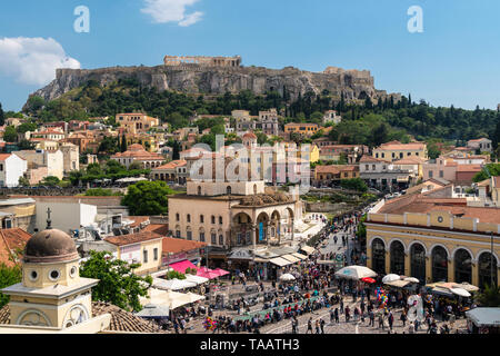 Athens, Greece - May 5 2019: Large crowd wandering around the Monastiraki square in Athens old town with the Acropolis and Parthenon temple on a sunny - Stock Photo