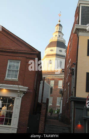 Maryland State House seen behind buildings in Annapolis, MD, USA - Stock Photo