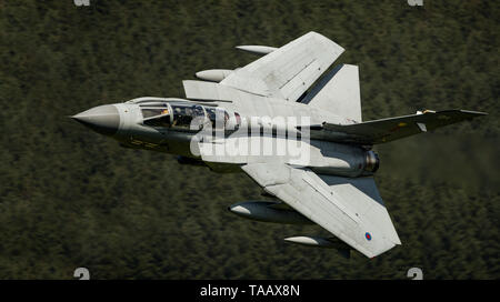 RAF Panavia Tornado GR4 jet flying low level through the Mach Loop, Wales, UK - Stock Photo