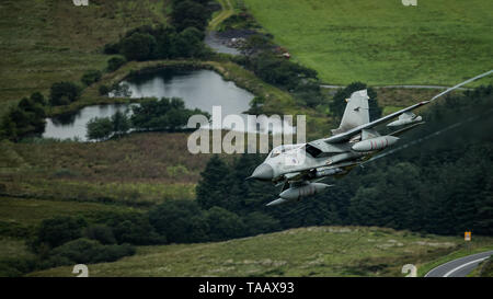 RAF Panavia Tornado GR4 flying low level through the Mach Loop in Wales, UK - Stock Photo