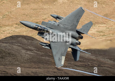 A USAF F-15E Strike Eagle exits the Bwlch Exit in the Mach Loop in Wales, UK - Stock Photo