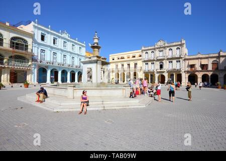 HAVANA, CUBA - FEBRUARY 27, 2011: People visit the Old Town Square (Plaza Vieja) in Havana, Cuba. Havana is the largest city in Cuba and its Old Town  - Stock Photo