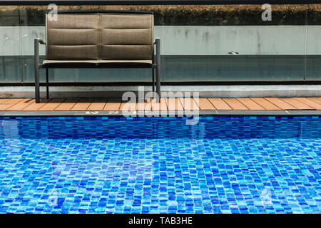 outside swimming pool side with chair - Stock Photo