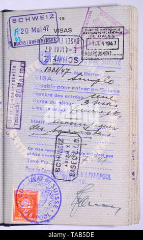 Page in 1940's vintage British blue passport with entry visa stamps - Stock Photo