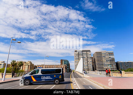 Valencia, Spain - May 19, 2019: Spanish national police van cutting traffic on a bridge in Valencia during a sporting event. - Stock Photo
