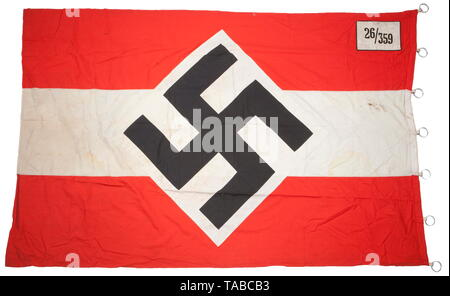 An HJ unit flag Double-sided, multi-piece, red cotton construction. Applied white stripe with red, black and white HJ diamond. White wool corner panel with black chain stitched '26/359'. Hoist edge retains all seven 'RZM M3/40/38' marked aluminium rings. Minor stains. Approximately 110 x 170 cm. USA-lot, see page 4. historic, historical, 20th century, 1930s, League of German Girls, Band of German Maidens, youth organization, youth organizations, NS, National Socialism, Nazism, Third Reich, German Reich, Germany, National Socialist, Nazi, Nazi period, utensil, piece of equip, Editorial-Use-Only - Stock Photo