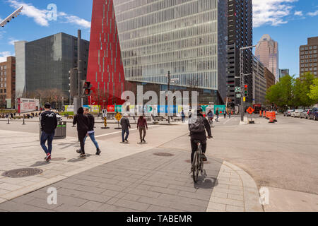 Montreal, Canada - 21 May 2019: Jeanne Mance street and Îlot Balmoral building in Montreal Downtown, in spring. - Stock Photo