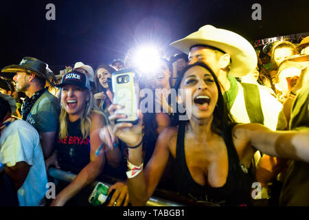 Indio, California, April 26, 2019, An energetic crowd on day 1 of the Stagecoach Country Music Festival. - Stock Photo
