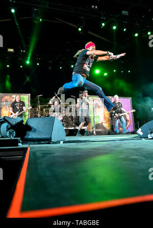 Indio, California, April 26, 2019, Bret Michaels Band on stage performing to an energetic crowd on day 1 of the Stagecoach Country Music Festival. - Stock Photo