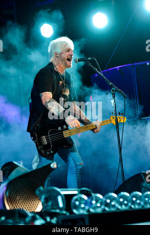 Indio, California, April 26, 2019, Eric Brittingham of the Bret Michaels Band on stage performing to an energetic crowd on day 1 of the Stagecoach Cou - Stock Photo