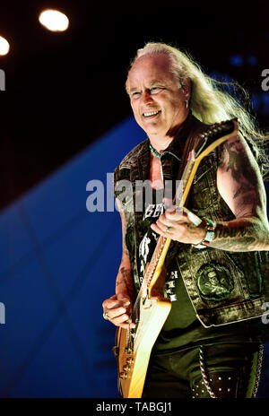 Indio, California, April 27, 2019, Rickey Medlocke of Lynyrd Skynyrd on stage performing to an energetic crowd at the Stage Coach Music Festival. - Stock Photo