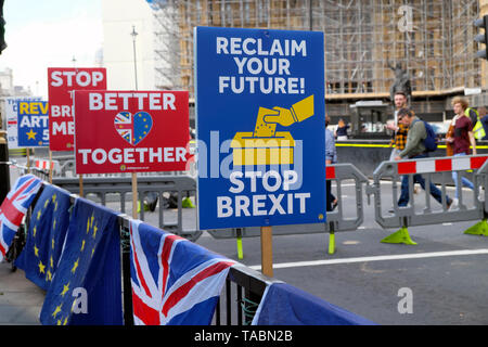 RECLAIM YOUR FUTURE, STOP BREXIT, BETTER TOGETHER heart and EU BREXIT STOP THE BREXIT MESS remain posters placards and flags and banners on barriers in the street outside the Houses of Parliament in Westminster London England UK 21 May 2019  KATHY DEWITT - Stock Photo