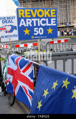 Revoke Article 50 and The Best Deal is with EU remainer Brexit posters flags and banners in the street outside the Houses of Parliament in Westminster London England UK  21 May 2019 KATHY DEWITT - Stock Photo