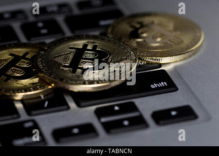 Bitcoin close up on computer keyboard. Investing in financial sector.