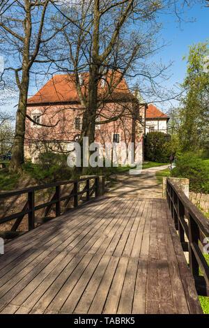 DEBNO, POLAND - APRIL 25, 2019: Late Gothic castle in Debno, near Tarnow, in spring scenery,Poland. - Stock Photo