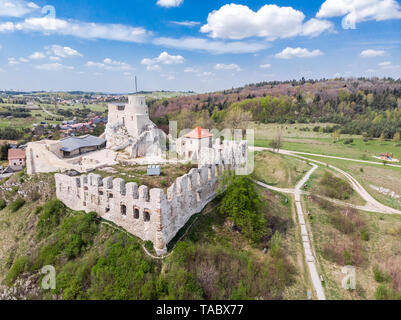 Aerial view of medieval Rabsztyn Castle ruins on hill top in sunny day, in Poland. - Stock Photo