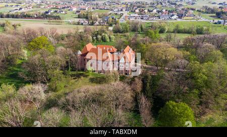 DEBNO, POLAND - APRIL 25, 2019: Aerial drone view of late Gothic castle in Debno, near Tarnow, in spring scenery,Poland. - Stock Photo