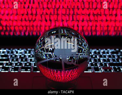 Globe illustrating the Americas on a laptop computer with screen been infected by a cyber attack