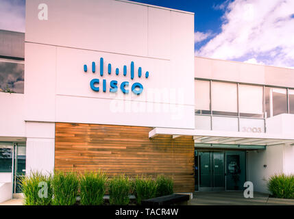 Santa Clara, CA / USA - March 26, 2019: Cisco Systems, Inc, an American technology office in the Silicon Valley,  develops, manufactures networking - Stock Photo